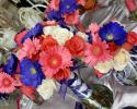 Dyed purple and coral gerbera daisies with coral roses