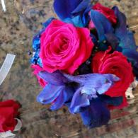 Blue and pink corsage on a wristlet