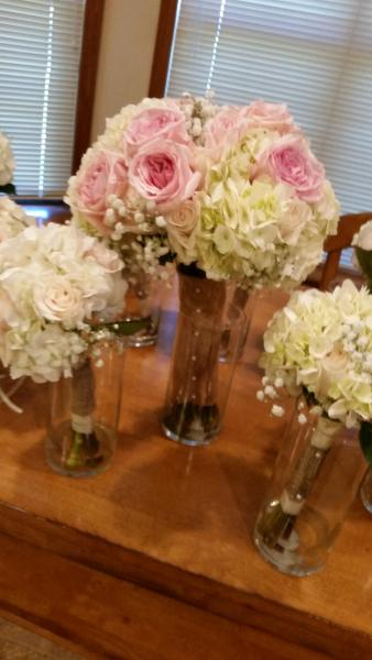 Pink roses with white hydrangeas wrapped in burlap