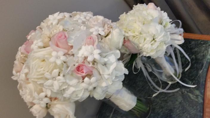 White hydrangeas with blush roses and stephanotis