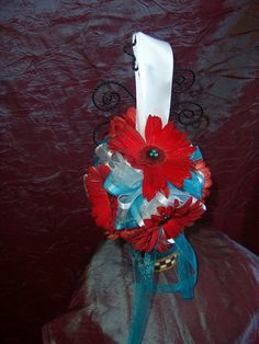 red gerbera daisies with turquoise ribbon