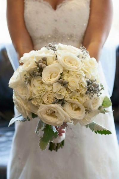 White roses with white hydrangeas and dusty miller